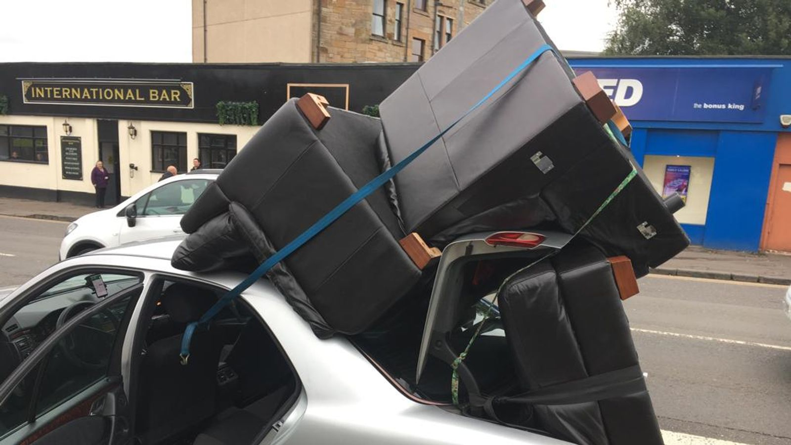 Driver caught with sofas strapped to car roof