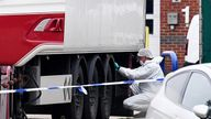 Forensic officers investigate the lorry