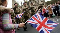 Some of the 350 Soldiers from 9 Theatre Logistic Regiment, The Royal Logistic Corps (9 TLR), march through the centre of Malmesbury as they hold an operational medals parade to mark their return from Afghanistan on October 31, 2013 in Malmesbury, England