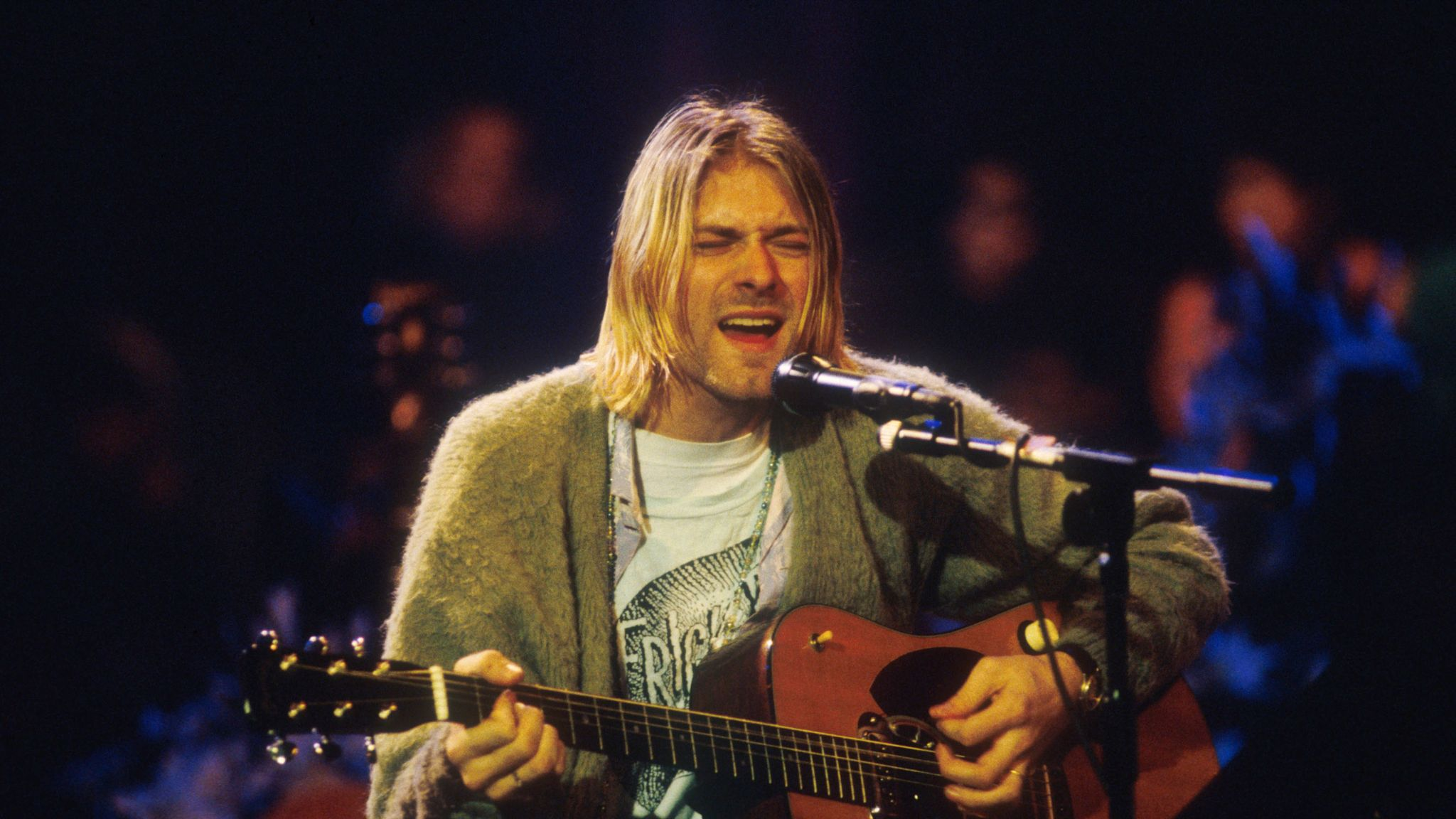 Kurt Cobain S Cigarette Burned Cardigan Sells At Auction For