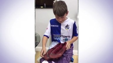 Young fan gets boots from hero