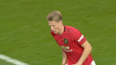 Alisson saves from McTominay (25)