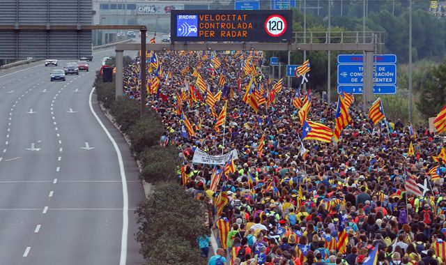 Protests paralyse Catalonia as fugitive ex-leader Puigdemont hands himself in