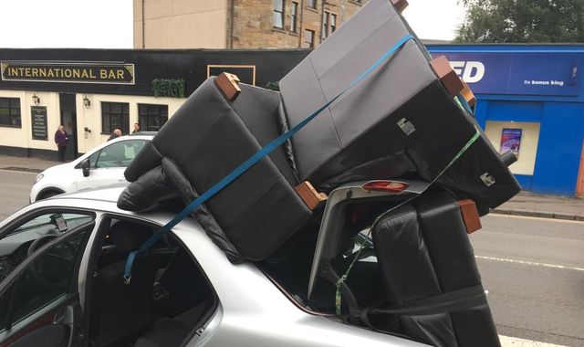 Driver caught with sofas and chairs strapped to car roof