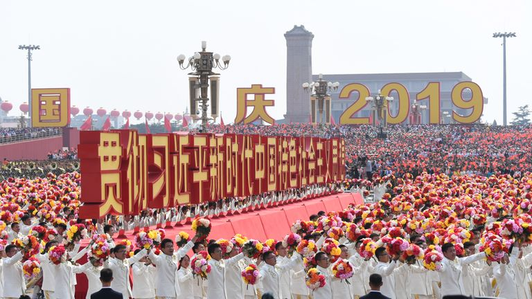 "A float with a slogan which reads ""Implement Xi Jinping Thought on Socialism with Chinese Characteristics for a New Era"" passes by Tiananmen Square during the National Day parade in Beijing on October 1, 2019, to mark the 70th anniversary of the founding of the People's Republic of China. (Photo by GREG BAKER / AFP)        (Photo credit should read GREG BAKER/AFP/Getty Images)"