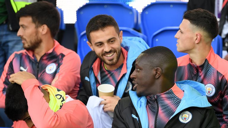 LIVERPOOL, ENGLAND - SEPTEMBER 28: Bernardo Silva of Manchester City speaks to Benjamin Mendy of Manchester City on the bench during the Premier League match between Everton FC and Manchester City at Goodison Park on September 28, 2019 in Liverpool, United Kingdom. (Photo by Michael Regan/Getty Images)