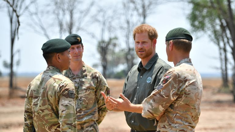 The Duke of Sussex meets British soldiers at the memorial site for Guardsman Mathew Talbot of the Coldstream Guards at the Liwonde National Park in Malawi, on day eight of the royal tour of Africa.