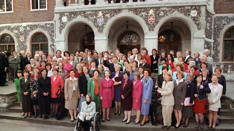 Prime Minister Tony Blair surrounded by his 101 women MPs outside Church House, at Westminster, London.