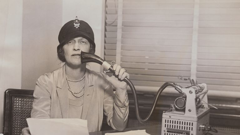 (Original Caption) Lady Astor, British parliamentarian, reading from a brief into a dictaphone device.