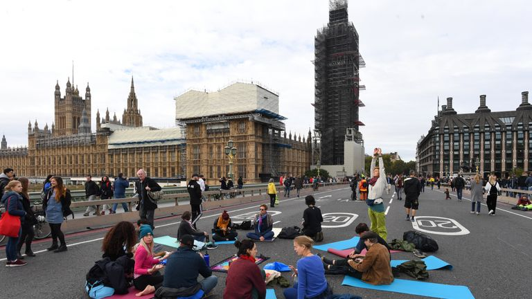 Protestors performing yoga on Westminster bridge during an Extinction Rebellion protest in Westminster, London.