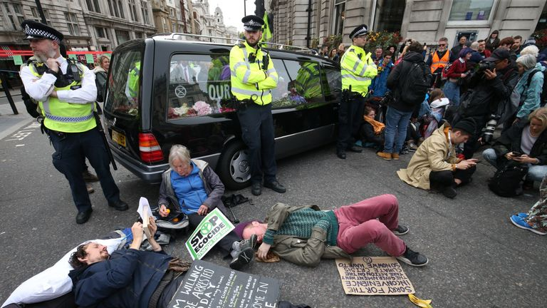 A hearse is used to block the road at the junction of Whitehall and Trafalgar Square during the Extinction Rebellion protest London.
