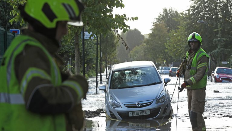 Firefighters on a flooded street in Finsbury Park, north London, after a pipe burst on Tuesday morning.