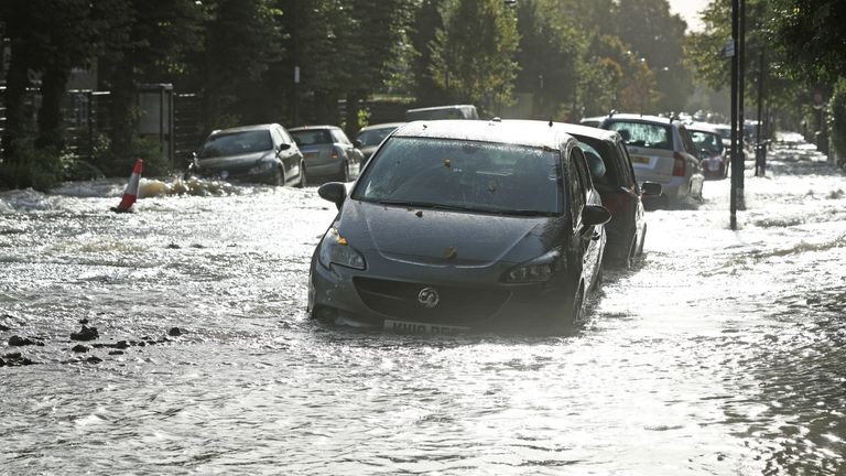Parked cars are part submerged on a flooded street in Finsbury Park, north London, after a pipe burst on Tuesday morning.