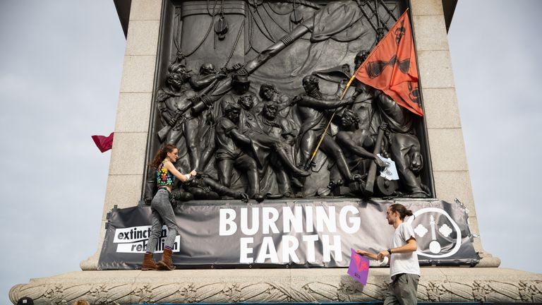 Protesters during an Extinction Rebellion (XR) protest in Trafalgar Square, London.