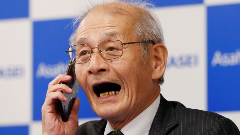 Asahi Kasei honorary fellow Akira Yoshino, 2019 Nobel Prize in Chemistry winner, speaks on the phone with Japanese Prime Minister Shinzo Abe during a news conference in Tokyo, Japan October 9, 2019. REUTERS/Issei Kato