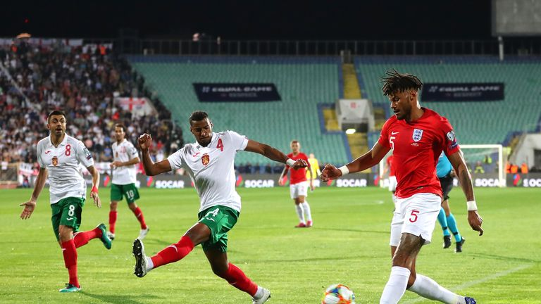 SOFIA, BULGARIA - OCTOBER 14: Tyrone Mings of England crosses under pressure from Georgi Pashov of Bulgaria during the UEFA Euro 2020 qualifier between Bulgaria and England on October 14, 2019 in Sofia, Bulgaria. (Photo by Catherine Ivill/Getty Images)