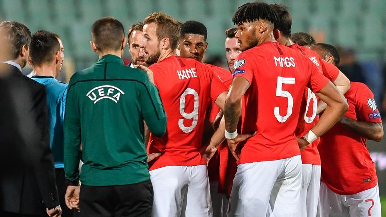 England's forward Harry Kane (C) speaks with the referees during a temporary interruption of the Euro 2020 Group A football qualification match between Bulgaria and England due to incidents with fans, at the Vasil Levski National Stadium in Sofia on October 14, 2019. (Photo by NIKOLAY DOYCHINOV / AFP) (Photo by NIKOLAY DOYCHINOV/AFP via Getty Images)
