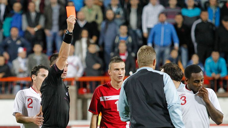 KRUSEVAC, SERBIA - OCTOBER 16: Referee Huseyin Gocek shows the red card to Danny Rose (R) of England after the Under 21 European Championship Play Off second leg match between Serbia U21 and England U21 at Stadium Mladost on October 16, 2012 in Krusevac, Serbia. (Photo by Srdjan Stevanovic/Getty Images)
