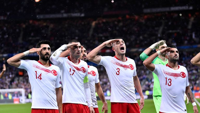 SAINT-DENIS, FRANCE - OCTOBER 14: (L-R) Mahmut Tekdemir, Burak Yilmaz, Merih Demiral and Umut Meras react by making a military salute after Kaan Ayhan goal during the UEFA Euro 2020 qualifier between France and Turkey on October 14, 2019 in Saint-Denis, France. (Photo by Aurelien Meunier/Getty Images)