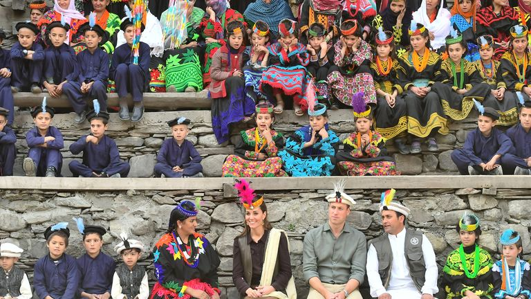 The Duke and Duchess of Cambridge (centre) during a visit to a settlement of the Kalash people in Chitral, Pakistan on the third day of the royal visit to the country.