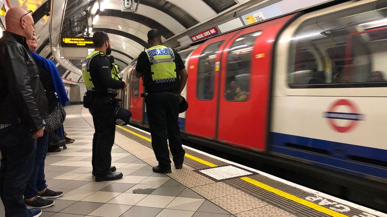 British Transport Police officers on patrol on the Central Line platform of Bank Underground station as two Extinction Rebellion demonstrators clambered aboard the carriage of a Docklands Light Railway (DLR) at Canary Wharf station in east London and say they will glue themselves to the roof, as part of the ongoing climate change protests in the capital.