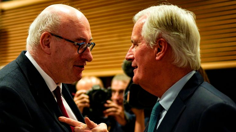 EU chief Brexit negotiator Michel Barnier (R) shakes hands with European Commissioner for Agriculture and Rural Development Phil Hogan as he departs after addressing a press conference ahead of an European Union Summit at European Union Headquarters in Brussels on October 17, 2019. (Photo by Kenzo TRIBOUILLARD / AFP) (Photo by KENZO TRIBOUILLARD/AFP via Getty Images)