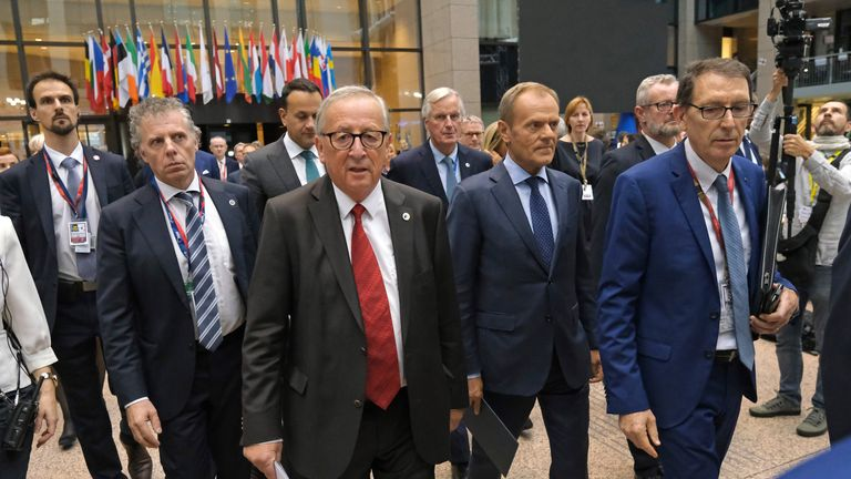 BRUSSELS, BELGIUM - OCTOBER 17: European Commission President Jean-Claude Juncker (C-L) and European Council President Donald Tusk (C-R) arrive to give statements to the media following the agreement by EU member state leaders of the Brexit deal at the summit of European Union leaders on October 17, 2019 in Brussels, Belgium. Officials announced earlier in the day that EU and UK negotiators have reached an agreement on the United Kingdom's departure from the EU. (Photo by Sean Gallup/Getty Images)