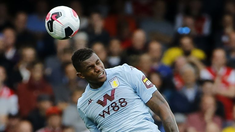 Aston Villa's Brazilian striker Wesley jumps to head the ball during the English Premier League football match between Arsenal and Aston Villa at the Emirates Stadium in London on September 22, 2019. (Photo by Tolga AKMEN / AFP) / RESTRICTED TO EDITORIAL USE. No use with unauthorized audio, video, data, fixture lists, club/league logos or 'live' services. Online in-match use limited to 120 images. An additional 40 images may be used in extra time. No video emulation. Social media in-match use limited to 120 images. An additional 40 images may be used in extra time. No use in betting publications, games or single club/league/player publications. /         (Photo credit should read TOLGA AKMEN/AFP/Getty Images)
