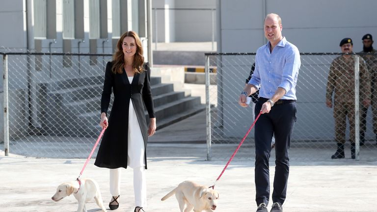 The Duke and Duchess of Cambridge with golden labrador puppies Salto and Sky during a visit to the Army Canine Centre, where the UK provides support to a programme that trains dogs to identify explosive devices, in Islamabad, on the fifth and final day of the royal visit to Pakistan.