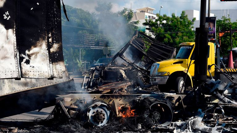 "View of burnt vehicles after heavily armed gunmen waged an all-out battle against Mexican security forces in Culiacan, Sinaloa state, Mexico, on October 18, 2019. - Mexico's president faced a firestorm of criticism Friday as his security forces confirmed they arrested kingpin Joaquin ""El Chapo"" Guzman's son, then released him when his cartel responded with an all-out gun battle. (Photo by ALFREDO ESTRELLA / AFP) (Photo by ALFREDO ESTRELLA/AFP via Getty Images)"