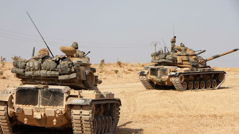 Turkish soldiers drive American-made M60 tanks in the town of Tukhar, north of Syria's northern city of Manbij, on October 14, 2019, as Turkey and its allies continue their assault on Kurdish-held border towns in northeastern Syria. - Syrian regime forces moved towards the Turkish border after Damascus reached a deal with beleaguered Kurdish forces following a US withdrawal announcement, AFP correspondents reported. (Photo by Aref TAMMAWI / AFP) (Photo by AREF TAMMAWI/AFP via Getty Images)