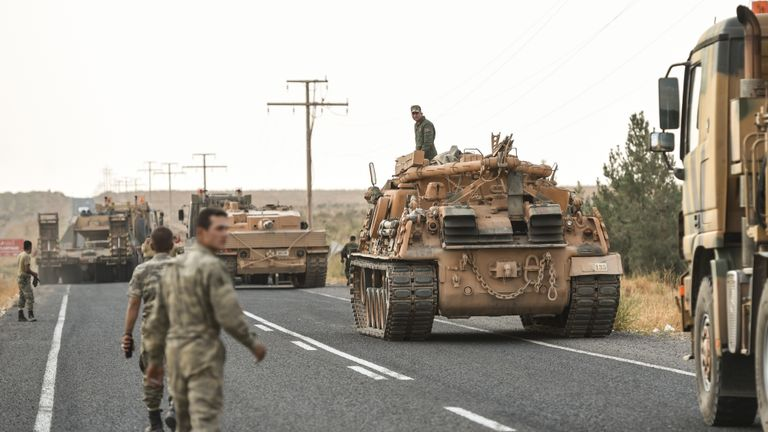 CEYLANPINAR, TURKEY - OCTOBER 18: A Turkish soldiers preparer the tanks as they secures the road before army tanks start moving towards the Syrian border on October 18, 2019 in Ceylanpinar, Turkey. Turkish forces appeared to continue shelling targets in Northern Syria despite yesterday's announcement, by U.S. Vice President Mike Pence, that Turkey had agreed to a ceasefire in its assault on Kurdish-held towns near its border. (Photo by Burak Kara/Getty Images)
