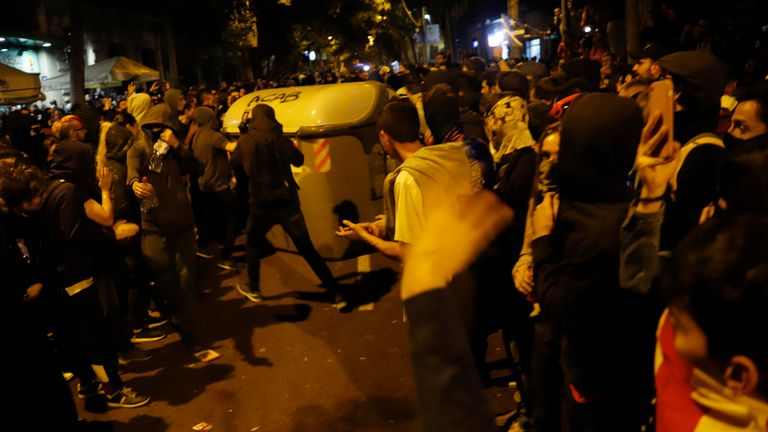 BARCELONA, SPAIN - OCTOBER 18 People move dumpster to mount barricades during a night clashes in the streets following a week of protests over the jail sentences given to separatist politicians by Spain's Supreme Court, on October 18, 2019 in Barcelona, Spain. Nine Catalan pro-independence leaders were sentenced earlier this week to varying jail terms for sedition, in relation to the 2017 independence referendum. (Photo by Clara Margais/Getty Images)