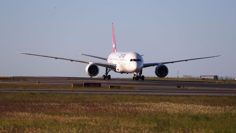 "SYDNEY, AUSTRALIA - OCTOBER 20: Qantas flight 7879 lands at Sydney Airport after flying 19 hours and 16 minutes from New York to Sydney on October 20, 2019 in Sydney, Australia. Qantas is the first commercial airline to ever fly direct from New York to Sydney. The flight was restricted to 40 people plus 10 crew to increase aircraft range, and included medical scientists and health experts on board to conduct studies in the cockpit and the cabin to help determine strategies to promote long haul inflight health and wellbeing on ultra-long haul flights. It comes as the national carrier continues to work towards the final frontier of global aviation by launching non-stop commercial flights between the US and the UK to the east coast of Australia in an ambitious project dubbed ""Project Sunrise"". (Photo by James D. Morgan/Getty Images for Qantas)"