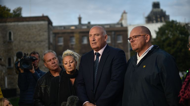 LONDON, ENGLAND - OCTOBER 09: Family spokesman Radd Seiger speaks on behalf of father of Harry Dunn, Tim Dunn (R) and mother Charlotte Charles (L) after meeting with Foreign Secretary Dominic Raab on October 9, 2019 in London, England. Motorcyclist Harry Dunn, 19, died in a collision with a car in Northamptonshire on August 27th. Anne Sacoolas, the wife of a US diplomat, was named as a suspect in the crash but later left the UK despite telling police she had no such plans. (Photo by Peter Summers/Getty Images)