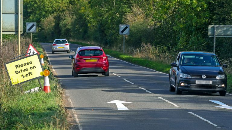 NUMBER PLATES PIXELLATED BY PA PICTURE DESK. Please Drive on Left signs and arrows have been placed on the B4031 road outside RAF Croughton, in Northamptonshire, where Harry Dunn, 19, died when his motorbike was involved in a head-on collision in August.