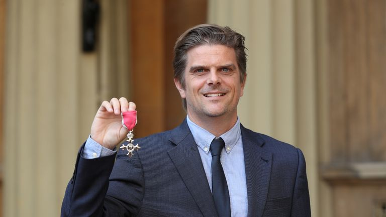 Jonathan Vaughan, Executive Director, Lilongwe Wildlife Trust, Malawi, with his Member of the Order of the British Empire (MBE) medal for services to combating the illegal wildlife trade in Malawi, following an investiture ceremony at Buckingham Palace, London.