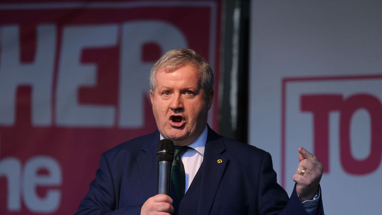 "Scottish National Party (SNP) Westminster leader Ian Blackford speaks on stage in Parliament Square in central London on October 19, 2019, during a rally by the People's Vote organisation calling for a final say in a second referendum on Brexit. - Thousands of people march to parliament calling for a ""People's Vote"", with an option to reverse Brexit as MPs hold a debate on Prime Minister Boris Johnson's Brexit deal. (Photo by ISABEL INFANTES / AFP) (Photo by ISABEL INFANTES/AFP via Getty Images)"
