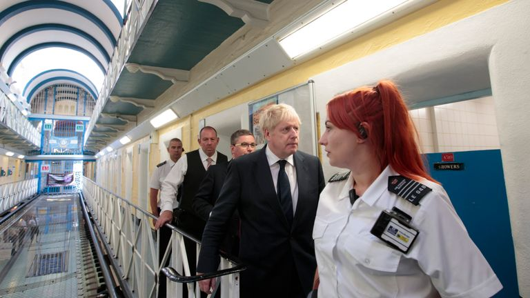 LEEDS, ENGLAND - AUGUST 13: UK Prime Minister Boris Johnson is taken on a tour during a visit to Leeds prison on August 13, 2019 in Leeds, England. In an announcement on Sunday Johnson promised more prisons and stronger police powers in an effort to fight violent crime (Photo by Jon Super - WPA Pool/Getty Images)
