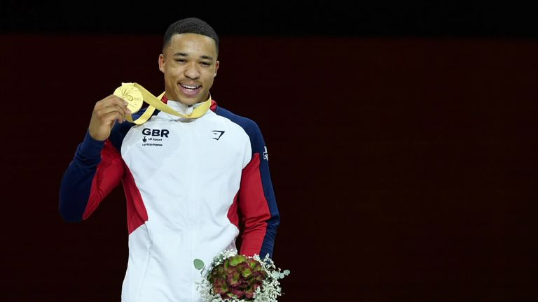 Joe Fraser celebrates winning Great Britain's first ever gold medal in the parallel bars
