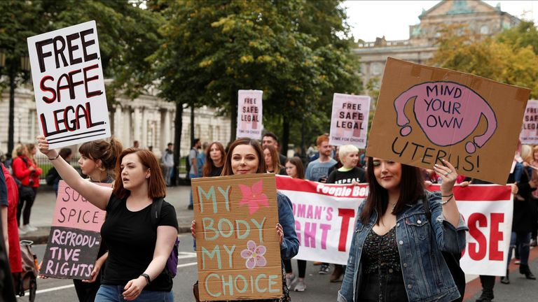 Pro-choice demonstrators take part in a march in Belfast