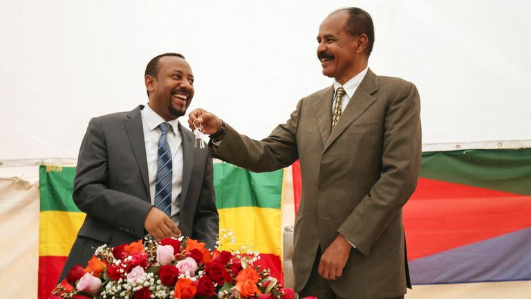Working with Eritrea's president Isaias Afwerki (right), Mr Ahmed helped a long-running conflict between their countries