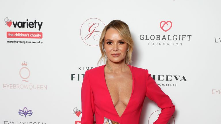 Amanda Holden has broken her leg in two places during a family holiday