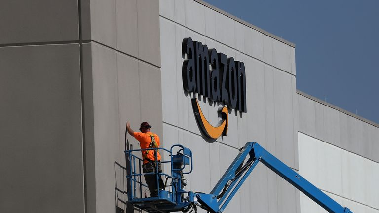 SACRAMENTO, CA - AUGUST 10: A worker makes repairs to a wall at a new Amazon fulfillment center on August 10, 2017 in Sacramento, California. Amazon is preparing to open a new 855,000-square-foot warehouse, the tenth in California, by early October and is expected to hire nearly 1,500 people. (Photo by Justin Sullivan/Getty Images)