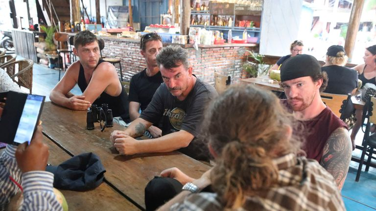 Phil Bambridge, centre, the father of missing backpacker Amelia Bambridge, sits with his family during a meeting with the governor of Koh Rong City Noun Bunthol