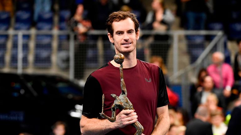 Britain's Andy Murray celebrates with the trophy after winning against Switzerland's Stanislas Wawrinka in their men's single tennis final match of the European Open ATP Antwerp, on October 20, 2019 in Antwerp. (Photo by JOHN THYS / BELGA / AFP) / Belgium OUT (Photo by JOHN THYS/BELGA/AFP via Getty Images)