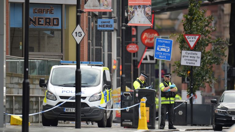 Police officers are seen outside the Arndale shopping centre