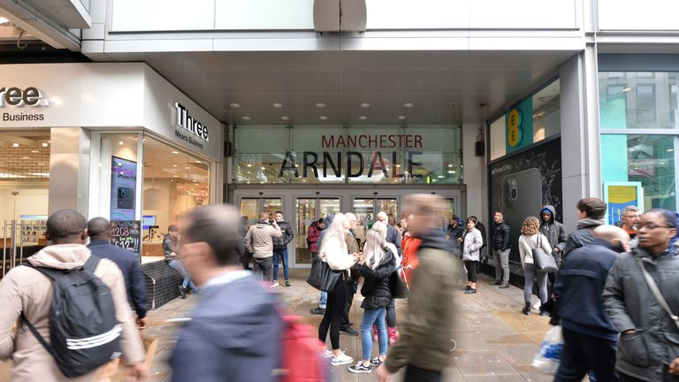 People walk past the entrance to the Arndale shopping centre