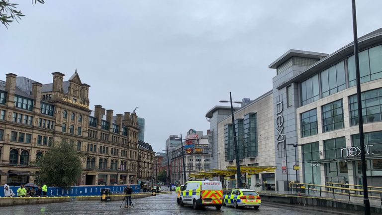 Police vehicles outside the Arndale Centre in Manchester. Pic: @xkimdunnell/PA Wire