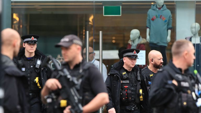 Armed police officers outside the Arndale Centre in Manchester